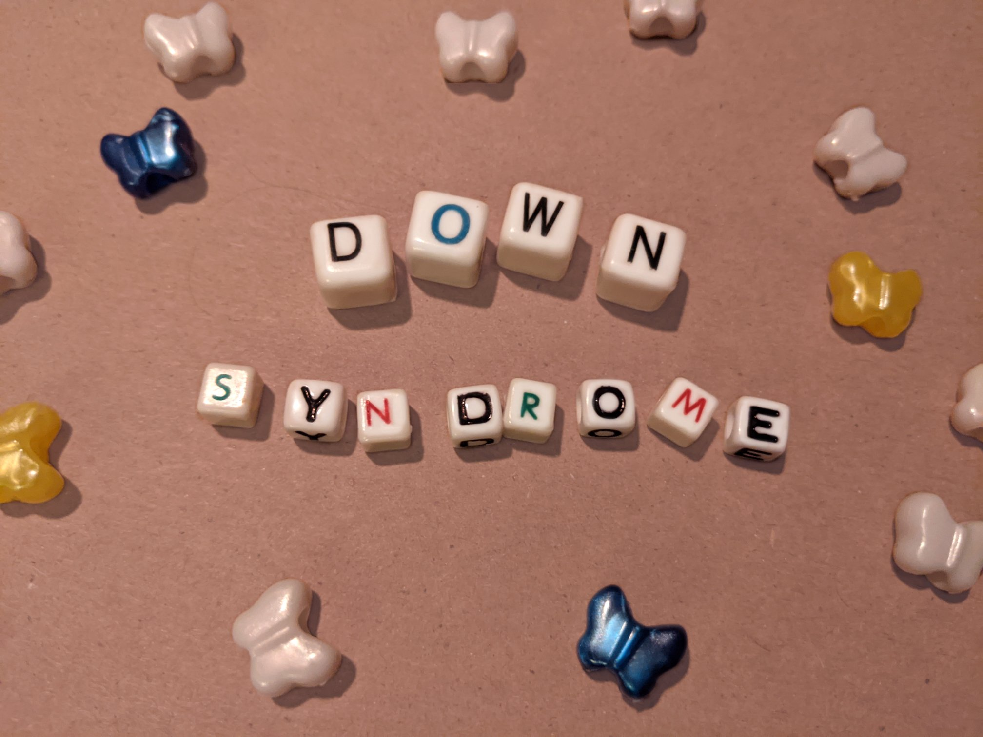 photo of beads spelling the word down syndrome